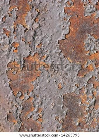 Peeling paint from rusting metal - stock photo