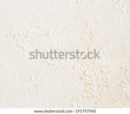 Peeling paint on light cream wall texture - stock photo