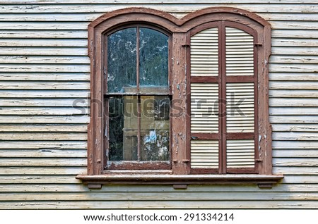 Peeling Paint on Old Curved Windows - stock photo