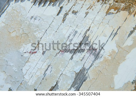 Peeling Paint on the Hull of an Old Boat  - stock photo