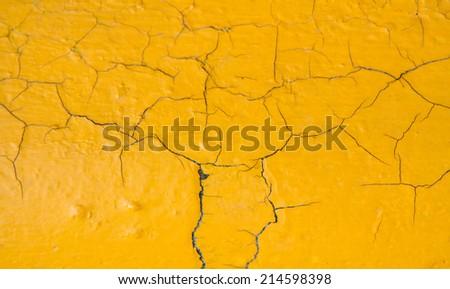 Peeling paint on wall texture. yellow background - stock photo