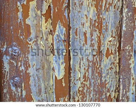 Peeling paint on worn and weathered wood planks on an old shed, makes interesting abstract patterns. - stock photo