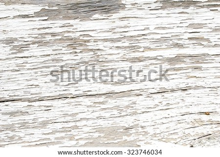 Peeling White Paint on a Piece of Old Wood - stock photo