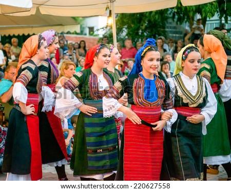 PEFKOHORI , GREECE - SEPTEMBER 19 2014 : Folk Dancers from Serbia taking part in the Annual Folk Dance festival in the village square of Pefkohori ,Greece - stock photo