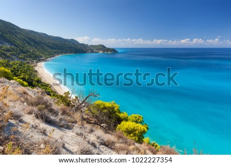 Pefkouliai beach with beautiful turquoise color of sea water on Lefkada island at idyllic sunny day