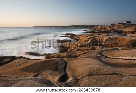 Peggy Cove Rocks at Sunset, Nova Scotia, Canada - stock photo