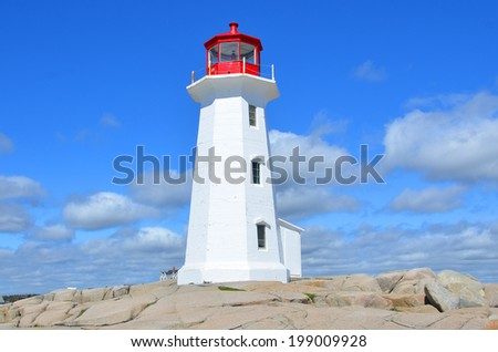 Peggy's Cove is a community located on the eastern shore of St. Margarets Bay in Nova Scotia's Halifax Regional Municipality, which is famous for the Peggys Point Lighthouse (established 1868). - stock photo