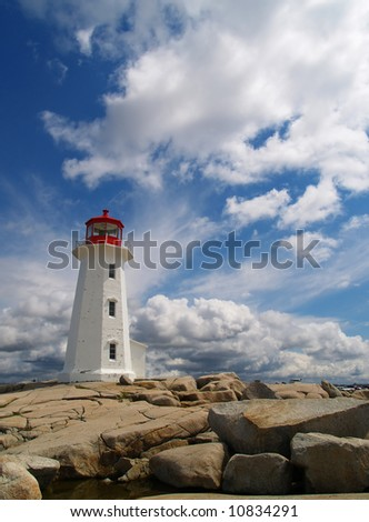Peggy's Cove lighthouse on an unusual day for the area, usually its all clouds or no clouds.