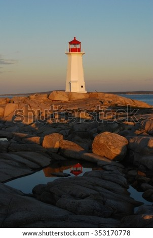 Peggy's Cove lighthouse reflected in a pool - stock photo