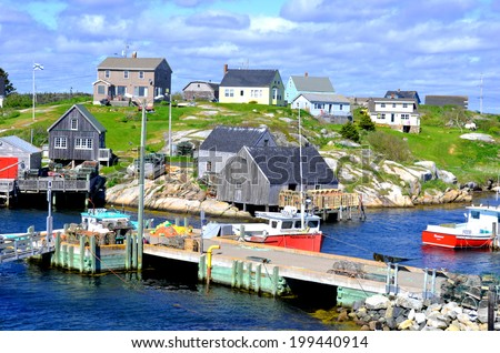 PEGGY'S COVE NOVA SCOTIA JUNE 6: Typical fisherman houses in Peggy's Cove a small rural community located on the eastern shore of St. Margarets Bay in Nova Scotia on june 6 2014.