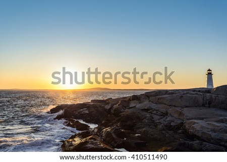 Peggys Cove Lighthouse at Sunset (Nova Scotia, Canada) - stock photo