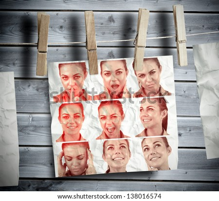 Pegs hanging pictures showing woman gesturing with wooden boards on the background - stock photo