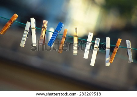 pegs on clothesline - stock photo