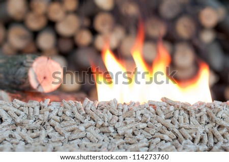 Pellets in  flames- selective focus on the heap - stock photo
