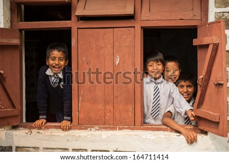PELLING,INDIA-APRIL 17:The Indian students at the window in Pelling school on April 17,2013 in Pelling,India. - stock photo