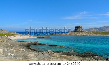 Pelosa beach with an ancient medieval tower on an isolated beach, Sardinia, Italy
