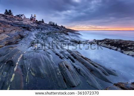 Pemaquid Point lighthouse at sunrise, Maine, USA - stock photo