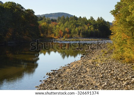 Pemigewasset River in North Woodstock, New Hampshire, in the White Mountains National Forest, with tree reflections on still water.