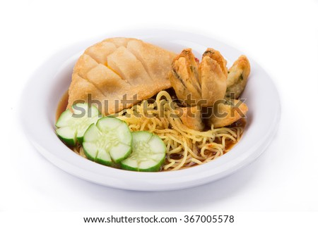 Pempek / indonesian spicy fish cakes noodles on white plate isolated on white background - stock photo