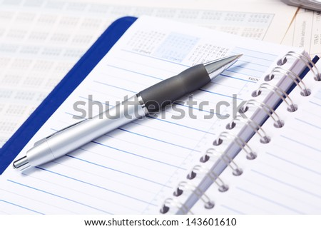 Pen and a notebook. Finance and accounting business.