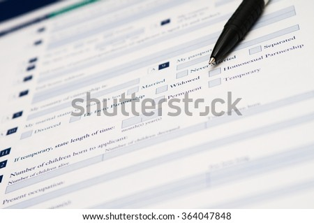 Pen and application form of marital status that requires to fill out his required information. - stock photo