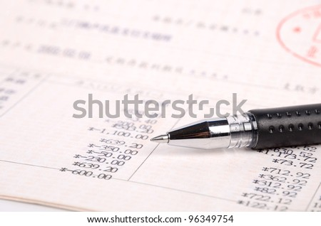 Pen and bank book - stock photo