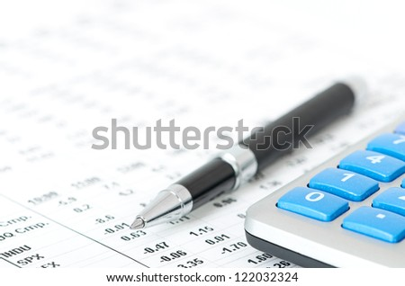 pen and calculator - stock photo