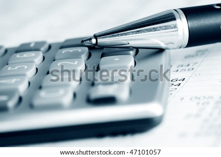Pen and calculator. - stock photo