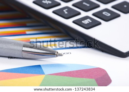 Pen and calculator. Finance and accounting business. - stock photo