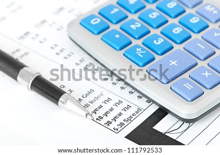 pen and calculator on a chart background
