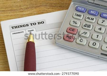 Pen and calculator on a 'Things To Do' pad