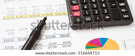 pen and calculator on business finance document
