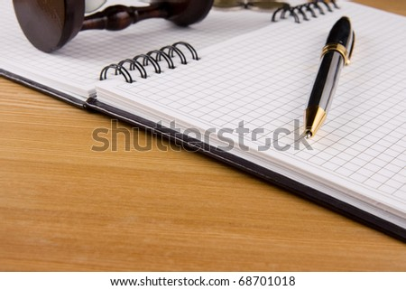 pen and coin on checked notebook