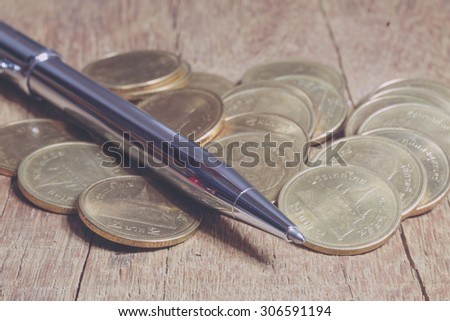 Pen and coins with filter effect retro vintage style