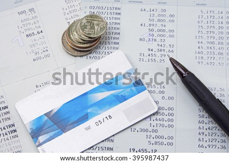 Pen and Credit card and Saving Account and Book Bank and cash