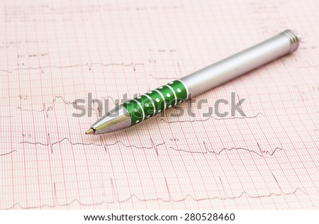 Pen and Financial graphs analysis - stock photo