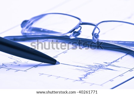 Pen and glasses on chart