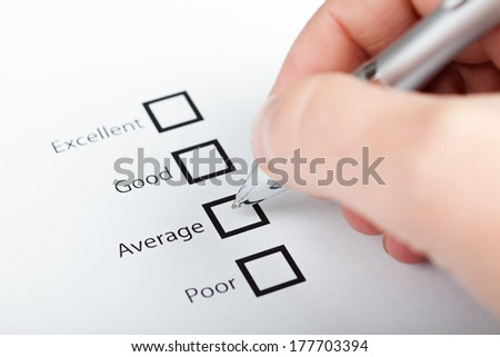 pen and marked check box  - stock photo