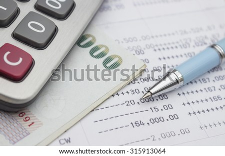pen and money on account passbook background,selective focus