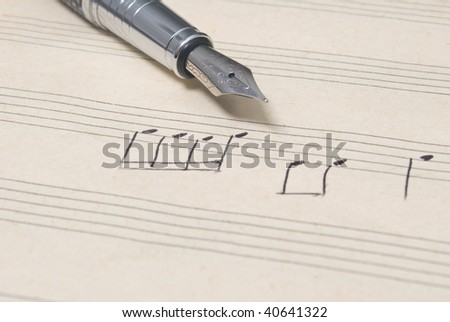pen and music sheet