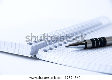 pen and note pad - stock photo