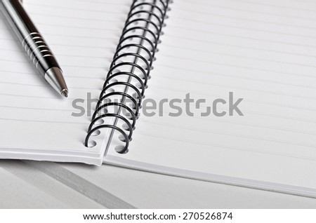 Pen and notebook on table - stock photo