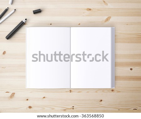 pen and open notebook on a wooden table - stock photo