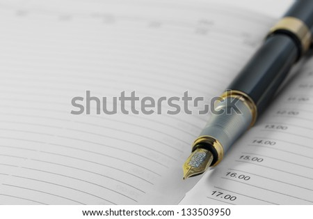 Pen and organizer - stock photo
