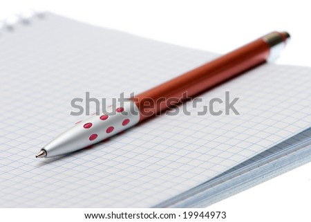 Pen and paper on a white background