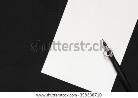 Pen and ring on paper background - stock photo