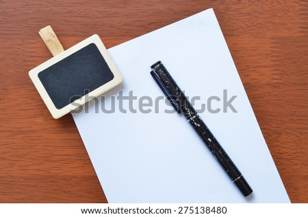 Pen and sign clip on the white blank paper - stock photo