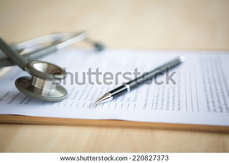 Pen and stethoscope on Patient information