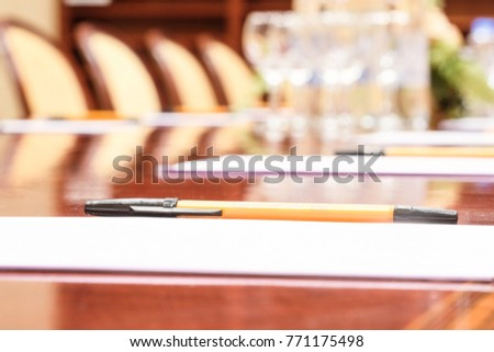 Pen and the paper on a table