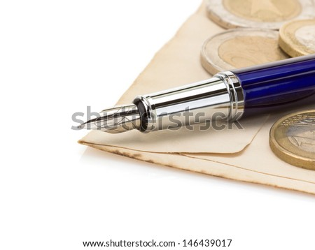 pen at old paper isolated on white background